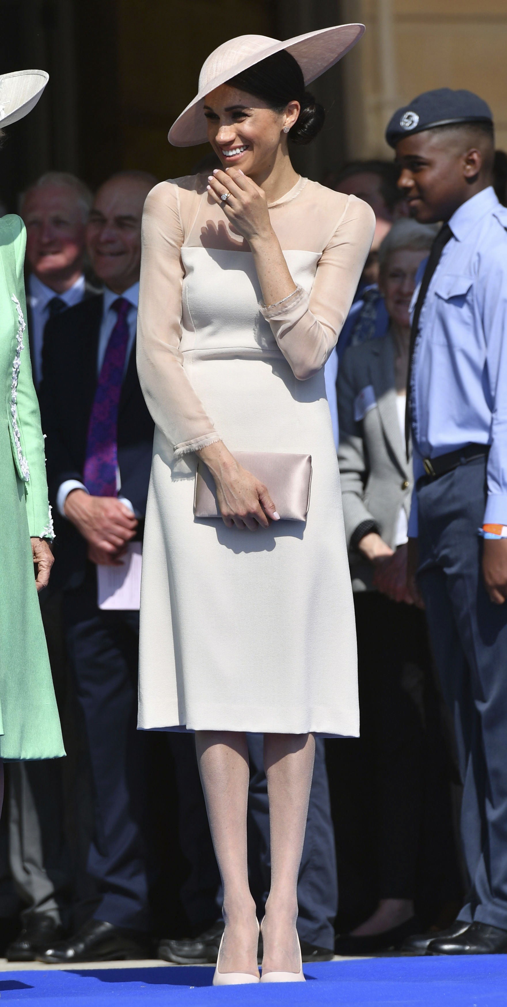 <div class='meta'><div class='origin-logo' data-origin='none'></div><span class='caption-text' data-credit='Dominic Lipinski/Pool Photo via AP'>Meghan, the Duchess of Sussex gestures as she attends a garden party at Buckingham Palace in London, Tuesday May 22, 2018.</span></div>