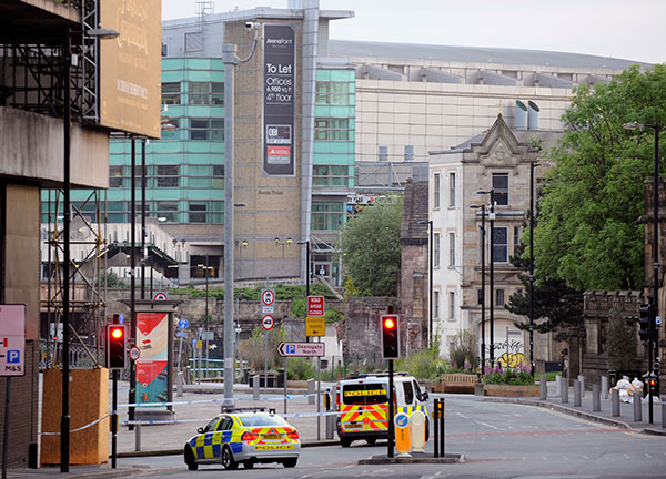 <div class='meta'><div class='origin-logo' data-origin='none'></div><span class='caption-text' data-credit='Rui Vieira/AP Photo'>Police block roads near to the Manchester Arena, seen at the right, in central Manchester, England Tuesday May 23, 2017.</span></div>