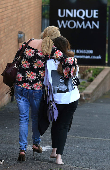 "<div class=""meta image-caption""><div class=""origin-logo origin-image none""><span>none</span></div><span class=""caption-text"">A fan is comforted as she leaves the Park Inn hotel in central Manchester, England, Tuesday May 23, 2017. (Rui Vieira/AP Photo)</span></div>"