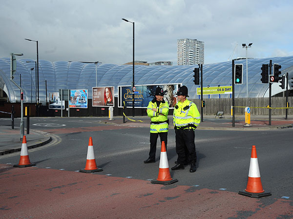 "<div class=""meta image-caption""><div class=""origin-logo origin-image none""><span>none</span></div><span class=""caption-text"">Police block a road outside the Manchester Arena in central Manchester, England Tuesday May 23, 2017. (Rui Vieira/AP Photo)</span></div>"