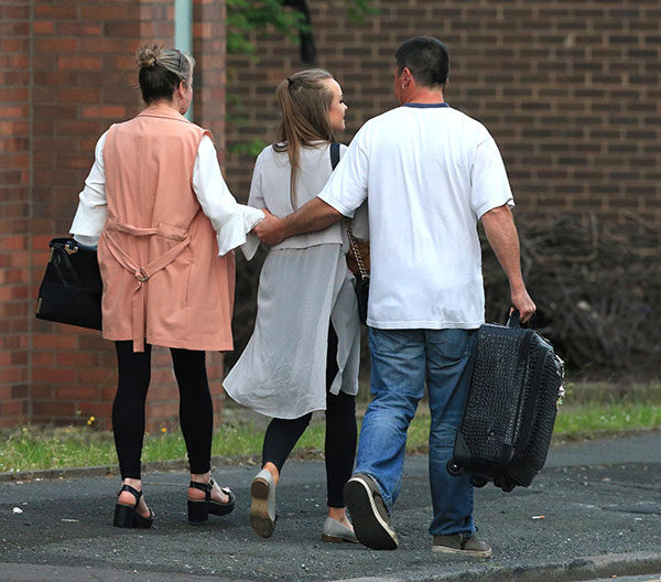 "<div class=""meta image-caption""><div class=""origin-logo origin-image none""><span>none</span></div><span class=""caption-text"">A fan leaves with parents at the Park Inn hotel in central Manchester, England Tuesday May 23 2017. (Rui Vieira/AP Photo)</span></div>"