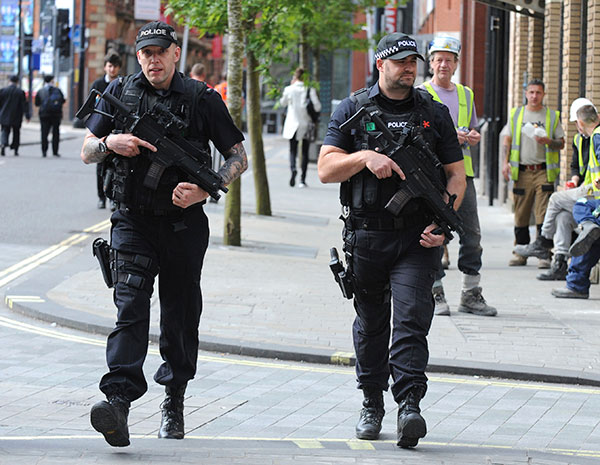 "<div class=""meta image-caption""><div class=""origin-logo origin-image none""><span>none</span></div><span class=""caption-text"">Armed police patrol the streets near to Manchester Arena in central Manchester, England, Tuesday May 23, 2017. (Rui Vieira/AP Photo)</span></div>"