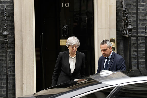 <div class='meta'><div class='origin-logo' data-origin='none'></div><span class='caption-text' data-credit='Matt Dunham/AP Photo'>British Prime Minister Theresa May departs 10 Downing Street, London, to go to Manchester, Tuesday May 23, 2017.</span></div>