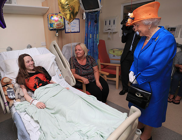 <div class='meta'><div class='origin-logo' data-origin='none'></div><span class='caption-text' data-credit='Peter Byrne/Pool via AP'>Queen Elizabeth II speaks to Manchester bombing victim Millie Robson, 15, and her mother, Marie, as she visits the Royal Manchester Children's Hospital on May 25, 2017.</span></div>