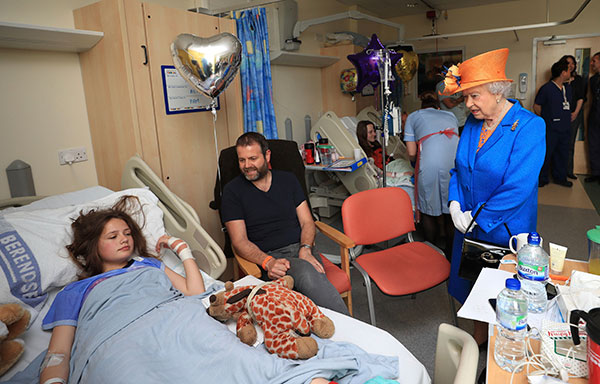 "<div class=""meta image-caption""><div class=""origin-logo origin-image none""><span>none</span></div><span class=""caption-text"">Queen Elizabeth II speaks to Manchester bombing victim Evie Mills, 14, from Harrogate, and her father Craig, as she visits the Royal Manchester Children's Hospital on May 25, 2017. (Peter Byrne/Pool via AP)</span></div>"