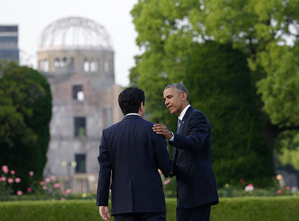 "<div class=""meta image-caption""><div class=""origin-logo origin-image none""><span>none</span></div><span class=""caption-text"">U.S. President Barack Obama and Japanese Prime Minister Shinzo Abe speak, with the Atomic Bomb Dome seen at rear. (Carolyn Kaster/AP Photo)</span></div>"