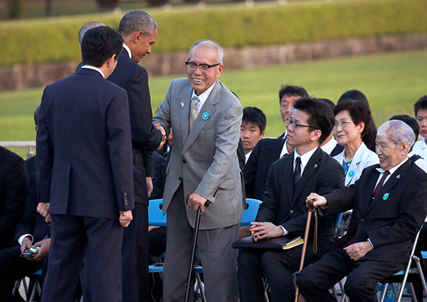 "<div class=""meta image-caption""><div class=""origin-logo origin-image none""><span>none</span></div><span class=""caption-text"">President Obama shakes hands with Shigeaki Mori, an atomic bomb survivor, historian and creator of the memorial for American WWII POWs killed at Hiroshima. (Carolyn Kaster/AP Photo)</span></div>"
