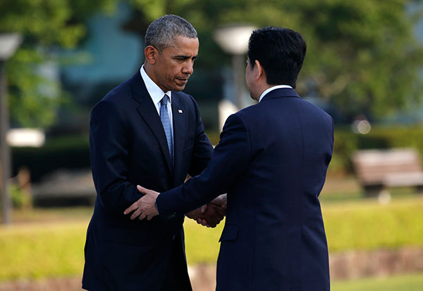 <div class='meta'><div class='origin-logo' data-origin='none'></div><span class='caption-text' data-credit='Shuji Kajiyama/AP Photo'>President Barack Obama, left, shakes hands with Japanese Prime Minister Shinzo Abe after laying a wreath at Hiroshima Peace Memorial Park in Hiroshima.</span></div>