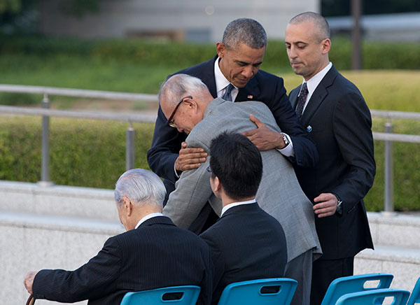 <div class='meta'><div class='origin-logo' data-origin='none'></div><span class='caption-text' data-credit='Carolyn Kaster/AP Photo'>U.S. President Barack Obama hugs Shigeaki Mori, an atomic bomb survivor, historian and creator of the memorial for American WWII POWs killed at Hiroshima.</span></div>