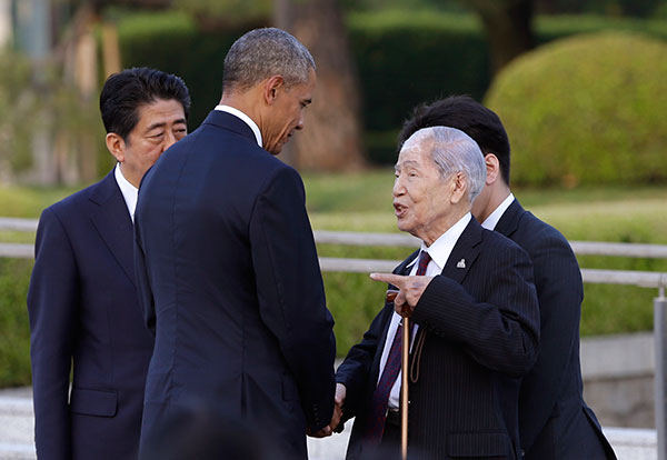 <div class='meta'><div class='origin-logo' data-origin='none'></div><span class='caption-text' data-credit='Carolyn Kaster/AP Photo'>Obama shakes hands and talks with Sunao Tsuboi, a survivor of the 1945 Atomic Bombing and chairman of the Hiroshima Prefectural Confederation of A-bomb Sufferers Organization.</span></div>