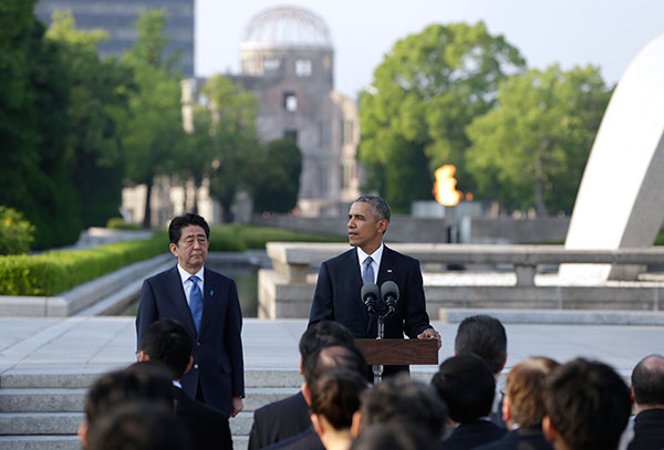 "<div class=""meta image-caption""><div class=""origin-logo origin-image none""><span>none</span></div><span class=""caption-text"">Obama, right, delivers remarks next to Japanese Prime Minister Shinzo Abe at Hiroshima Peace Memorial Park in Hiroshima, Japan, on May 27, 2016. (Carolyn Kaster/AP Photo)</span></div>"