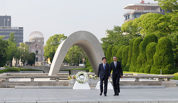 <div class='meta'><div class='origin-logo' data-origin='none'></div><span class='caption-text' data-credit='Carolyn Kaster/AP Photo'>President Obama and Japanese Prime Minister Shinzo Abe walk after laying wreaths at the cenotaph at the Hiroshima Peace Memorial Park</span></div>