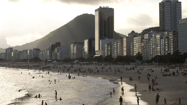 "<div class=""meta ""><span class=""caption-text "">Copacabana Beach: Often referred to as the world's most famous beach, Copacabana is three miles long and is lined with countless attractions for locals and visitors. (Silvia Izquierdo/AP)</span></div>"