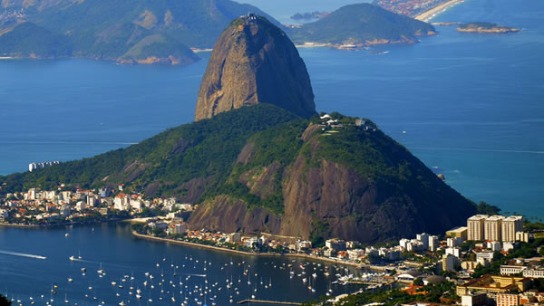"<div class=""meta ""><span class=""caption-text "">Sugarloaf Mountain: This beautiful 1,299-foot peak situated in Rio de Janeiro is at the mouth of Guanabara Bay on a peninsula that sticks out into the Atlantic Ocean. (caochopp/Flickr)</span></div>"
