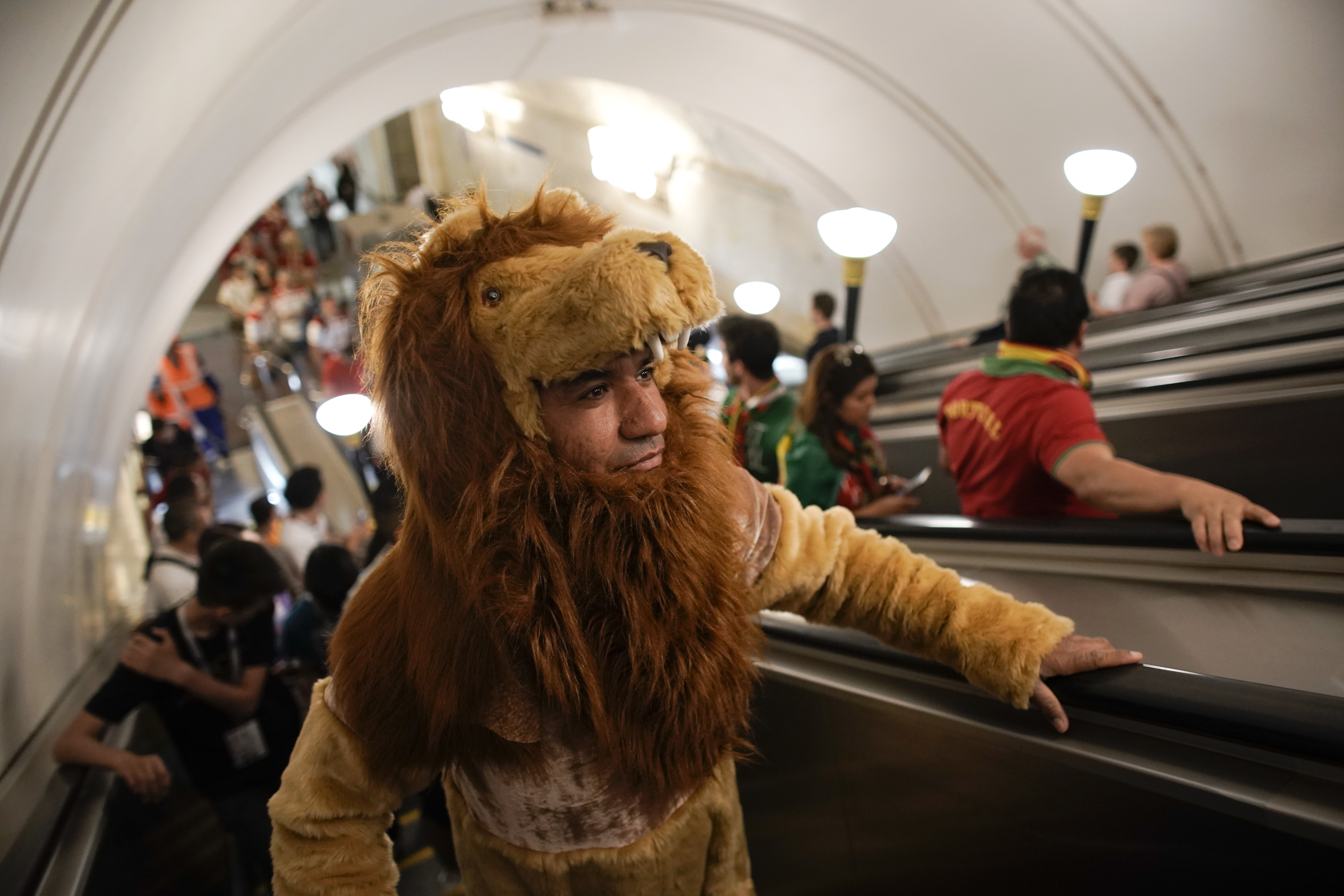 <div class='meta'><div class='origin-logo' data-origin='none'></div><span class='caption-text' data-credit='Victor R. Caivano/AP Photo'>A Morocco fan wearing a lion costume arrives at Sportivnaya metro station to attend the group B match between Portugal and Morocco in the Luzhniki Stadium in Moscow on June 20.</span></div>