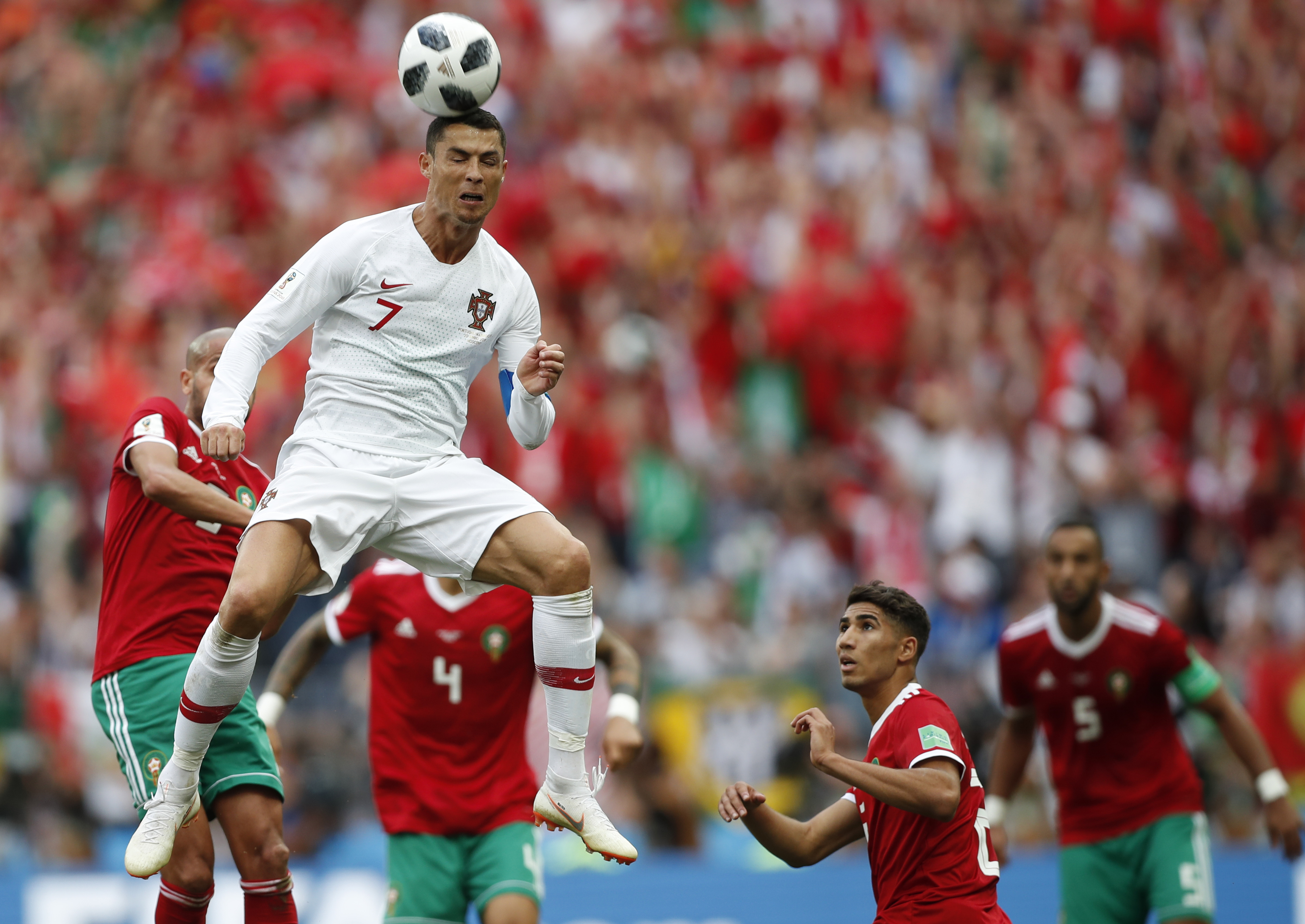 <div class='meta'><div class='origin-logo' data-origin='none'></div><span class='caption-text' data-credit='Francisco Seco/AP Photo'>Portugal's Cristiano Ronaldo leaps up for a header during the group B match against Morocco in the Luzhniki Stadium in Moscow, Russia, Wednesday, June 20, 2018.</span></div>