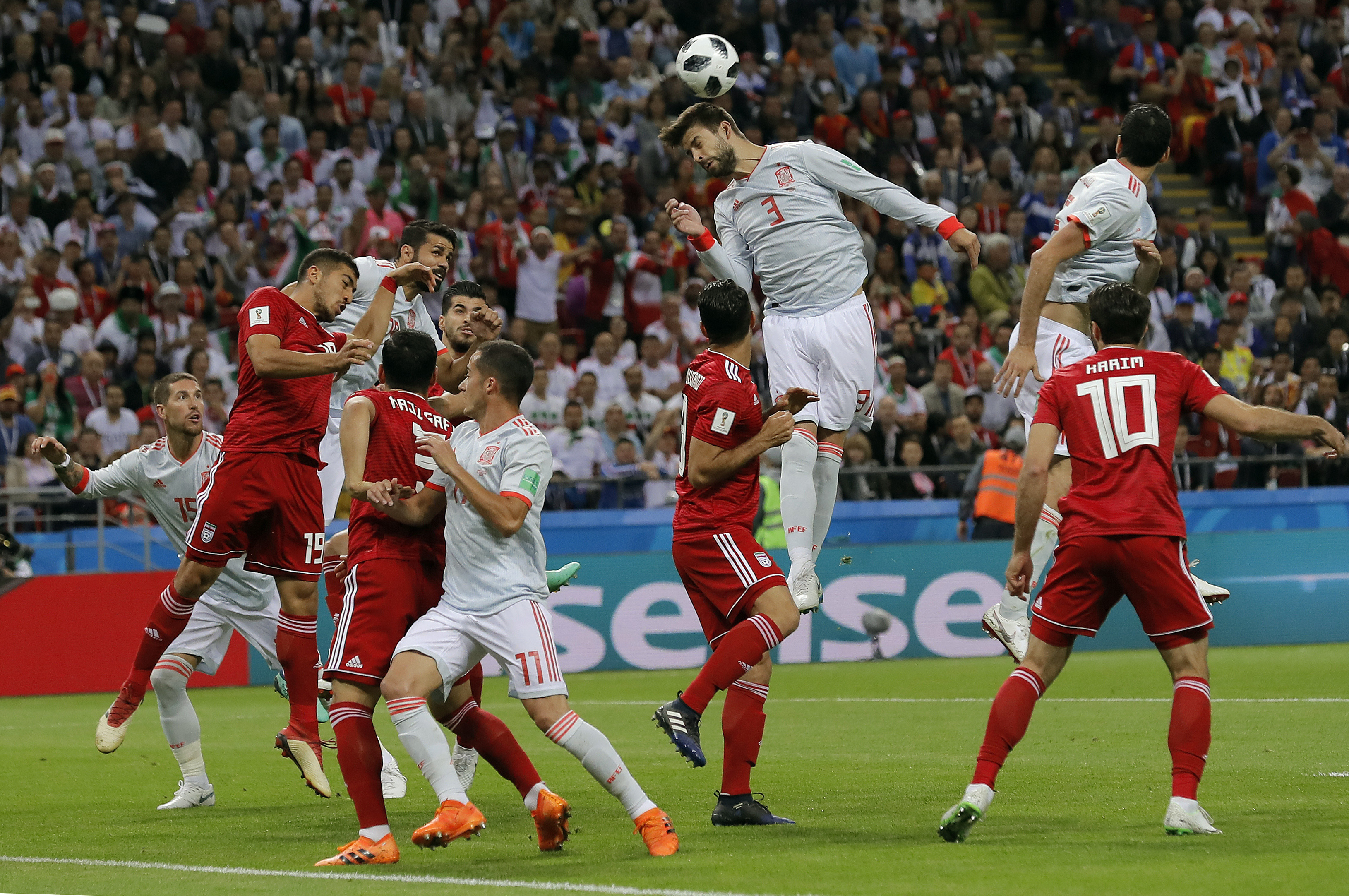 <div class='meta'><div class='origin-logo' data-origin='none'></div><span class='caption-text' data-credit='Manu Fernandez/AP Photo'>Spain's Gerard Pique, center, jumps for a header during the group B match between Iran and Spain at the 2018 soccer World Cup in the Kazan Arena in Kazan, Russia on June 20, 2018.</span></div>
