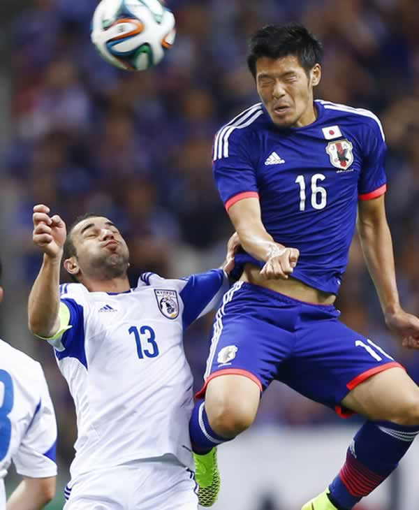 Japan&#39;s Hotaru Yamaguchi, right, fights for the ball with Cyprus&#39; Konstantinos Makridis during a friendly soccer match in Saitama, north of Tokyo, Tuesday, May 27, 2014. <span class=meta>(AP Photo&#47;Shizuo Kambayashi)</span>