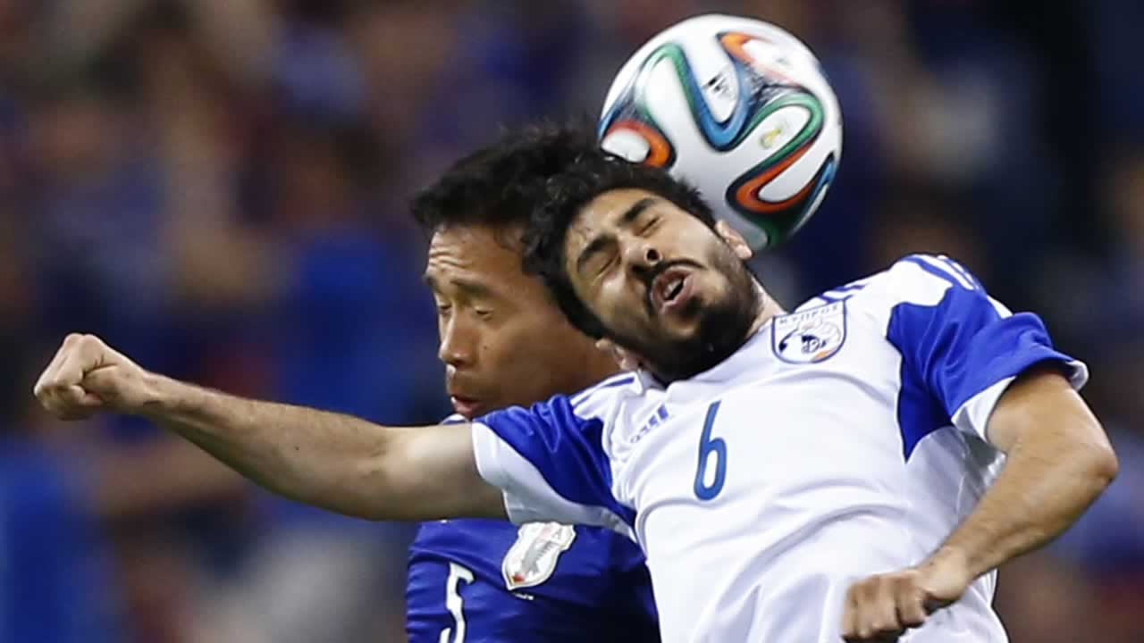 Cyprus&#39; Charalambos Kyriacou, right, fights for the ball with Japan?s Yuto Nagatomo during a friendly soccer match in Saitama, north of Tokyo, Tuesday, May 27, 2014. <span class=meta>(AP Photo&#47;Shizuo Kambayashi)</span>