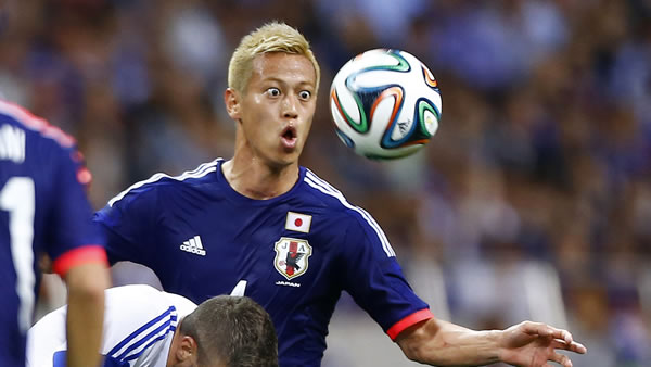 In this May 27, 2014 photo, Japan&#39;s Keisuke Honda, right, fights for the ball with Cyprus&#39; Giorgos Merkis during a friendly soccer match in Saitama, north of Tokyo. <span class=meta>(AP Photo&#47;Shizuo Kambayashi, File)</span>
