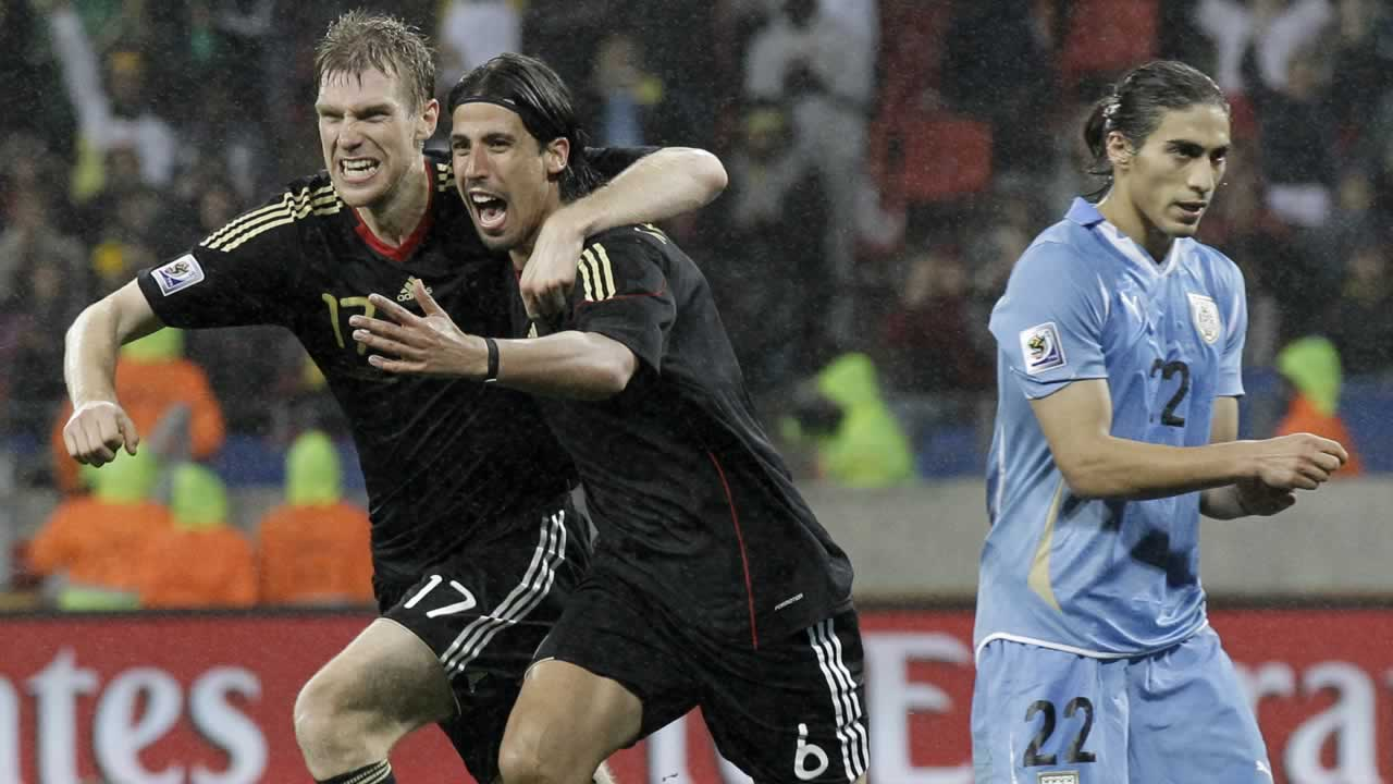 Germany&#39;s Sami Khedira, center, celebrates with teammate Germany&#39;s Per Mertesacker after scoring during the World Cup third-place soccer match between Germany and Uruguay.  <span class=meta>(AP Photo&#47;Gero Breloer)</span>