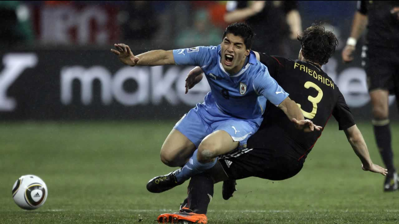 Uruguay&#39;s Luis Suarez, left, is tackled by Germany&#39;s Arne Friedrich during the World Cup third-place soccer match between Germany and Uruguay. <span class=meta>(AP Photo&#47;Julie Jacobson)</span>