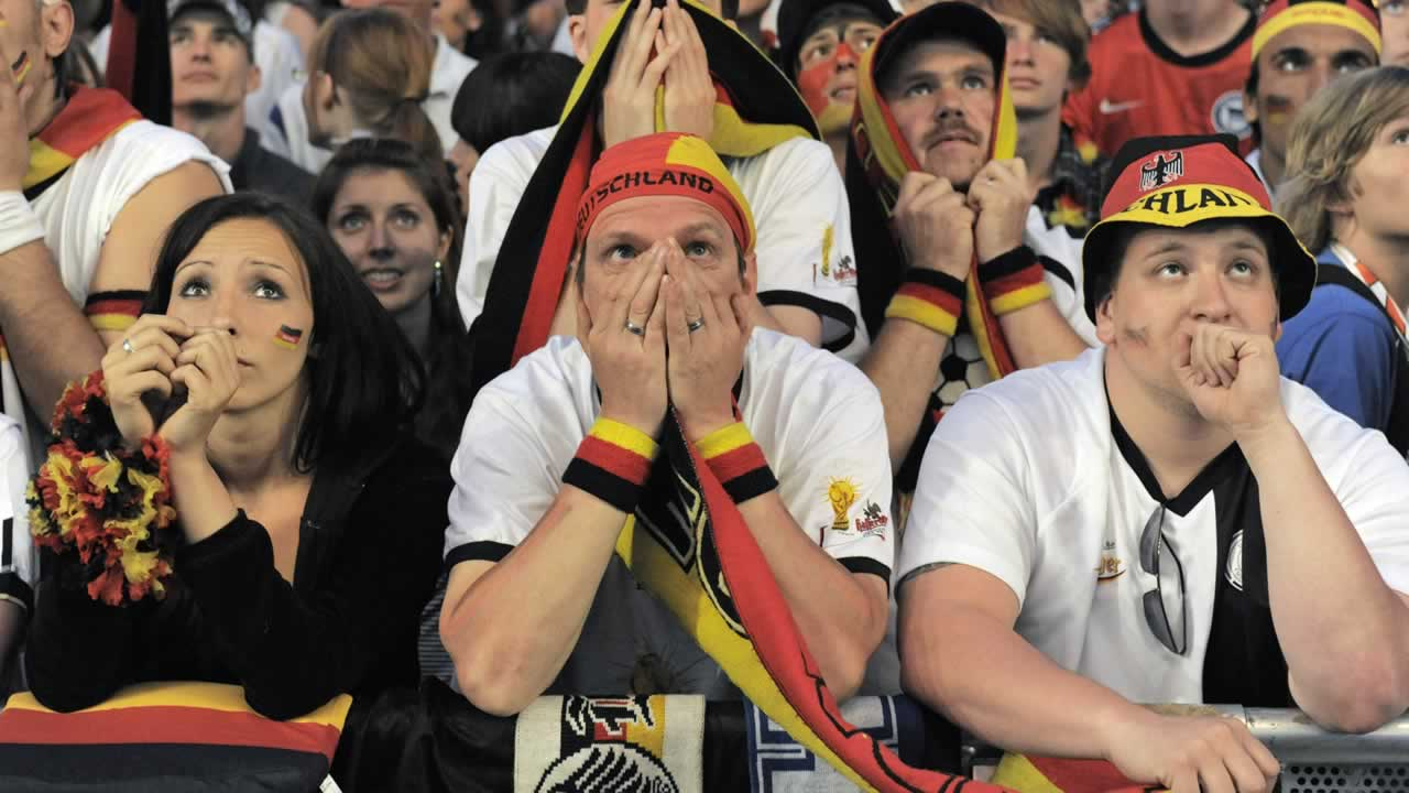 "<div class=""meta ""><span class=""caption-text "">German fans react during watching the World Cup soccer match between Germany and Spain at a public viewing area in Berlin, Germany on  July 7, 2010.  (AP Photo/Jens Meyer)</span></div>"