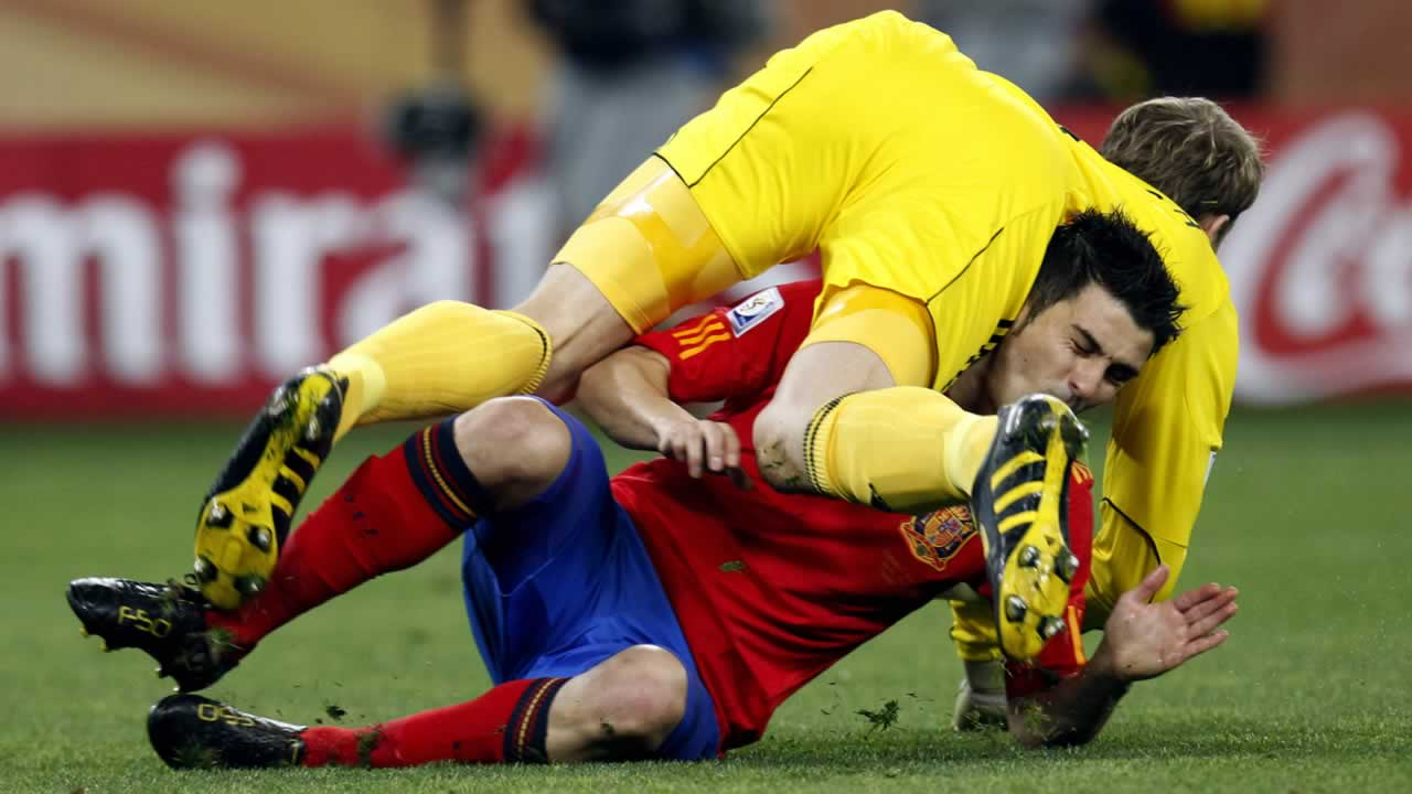 Germany goalkeeper Manuel Neuer, top, crashes into Spain&#39;s David Villa, bottom, during the World Cup semifinal soccer match between Germany and Spain. <span class=meta>(AP Photo&#47;Luca Bruno)</span>