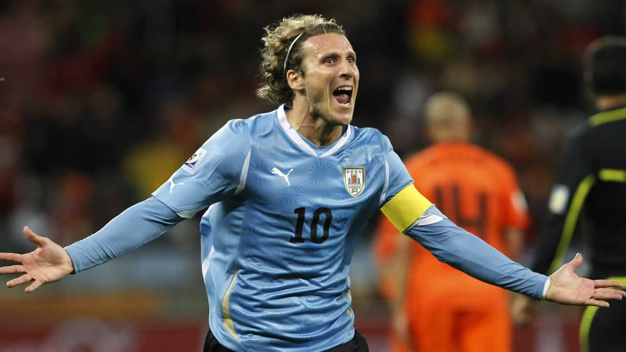 Uruguay&#39;s Diego Forlan celebrates after scoring his side&#39;s first goal during the World Cup semifinal soccer match between Uruguay and the Netherlands. <span class=meta>(AP Photo&#47;Bernat Armangue)</span>