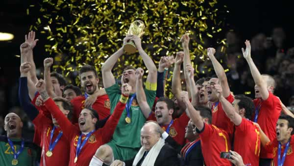 Spain team members celebrate with the World Cup trophy after the World Cup final soccer match between the Netherlands and Spain on July 11, 2010. <span class=meta>(AP Photo&#47;Frank Augstein)</span>