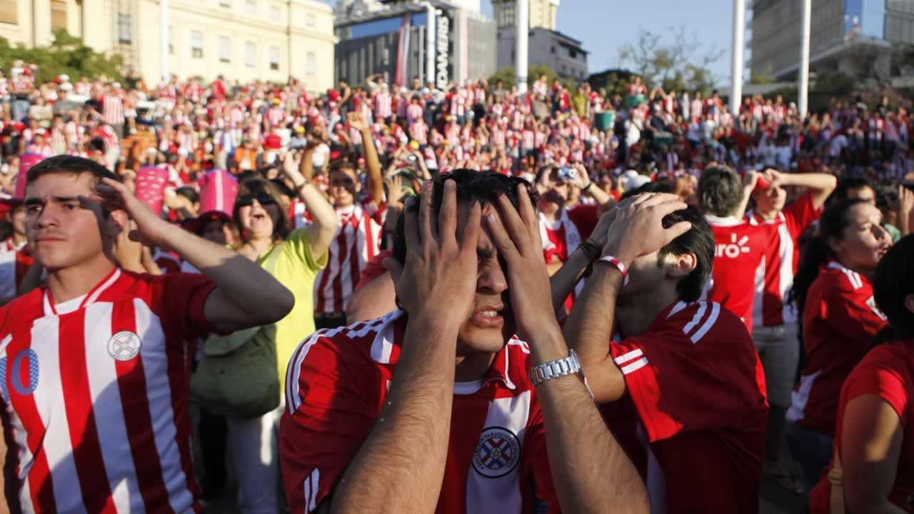 Fans of Paraguay&#39;s soccer team react after Spain scored against Paraguay as they watch the South Africa 2010 World Cup game on a screen in Asuncion, Saturday July 3, 2010.  <span class=meta>(AP Photo&#47;Jorge Saenz)</span>