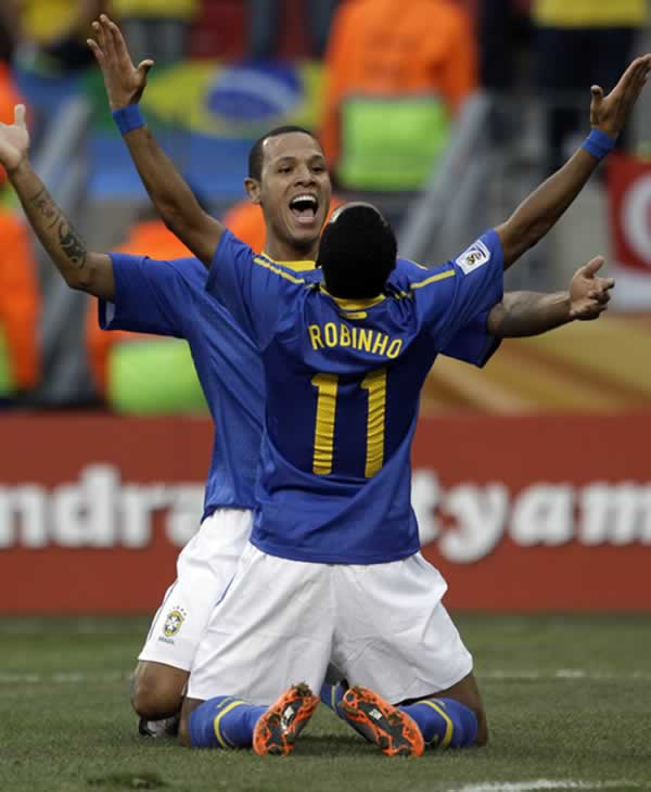 Brazil&#39;s Robinho celebrates with teammate Luis Fabiano after scoring his side&#39;s first goal during the World Cup quarterfinal soccer match between the Netherlands and Brazil. <span class=meta>(AP Photo&#47;Julie Jacobson)</span>