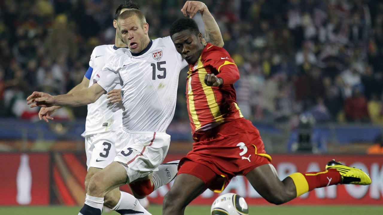 "<div class=""meta ""><span class=""caption-text "">Ghana's Asamoah Gyan scores a goal during the World Cup round of 16 soccer match between the United States and Ghana (AP Photo/Matt Dunham)</span></div>"