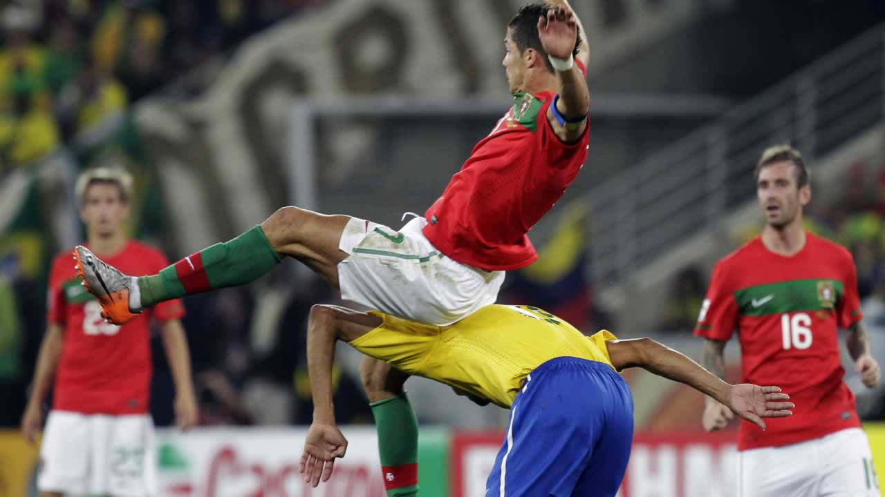 "<div class=""meta ""><span class=""caption-text "">Portugal's Cristiano Ronaldo, top, falls on Brazil's Gilberto Silva, bottom, as they compete for the ball during the World Cup group G soccer match between Portugal and Brazil. (AP Photo/Schalk van Zuydam)</span></div>"