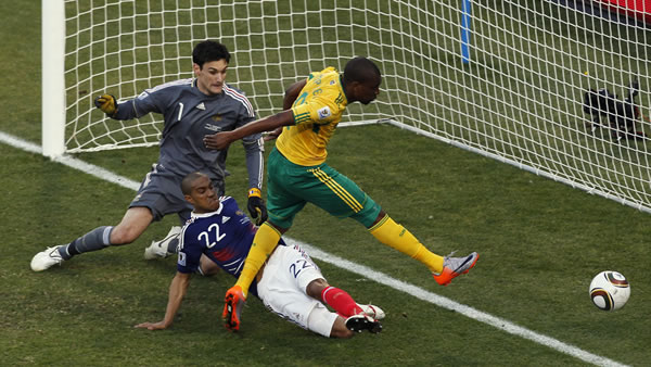 "<div class=""meta image-caption""><div class=""origin-logo origin-image ""><span></span></div><span class=""caption-text"">South Africa's Katlego Mphela, right, scores a goal past France goalkeeper Hugo Lloris, left, and France's Gael Clichy, center, during the World Cup group A soccer match. (AP Photo/Hassan Ammar)</span></div>"