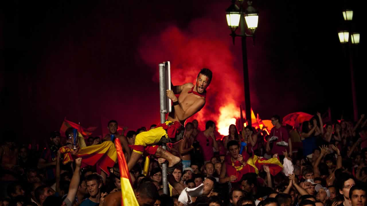 Spanish fans celebrate the goal as they watch in Barcelona&#39;s Plaza Espana a live broadcast of the World Cup soccer final between Spain and the Netherlands. <span class=meta>(AP Photo&#47;Emilio Morenatti)</span>