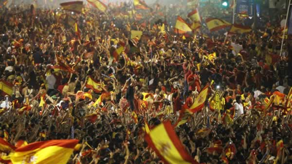 Spanish fans celebrate the goal as they watch in Barcelona&#39;s Plaza Espana a live broadcast of the World Cup soccer final between Spain and the Netherlands. <span class=meta>(AP Photo&#47;Victor R. Caivano)</span>