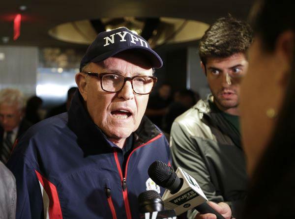 "<div class=""meta image-caption""><div class=""origin-logo origin-image none""><span>none</span></div><span class=""caption-text"">Former New York City Mayor Rudy Giuliani responds to questions before the ""True Blue"" benefit celebrity softball game at Yankee Stadium  (AP Photo/ Frank Franklin II)</span></div>"