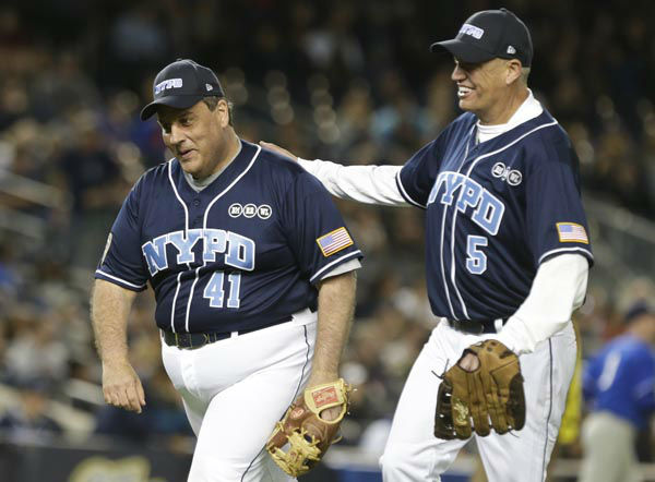 """<div class=""""meta image-caption""""><div class=""""origin-logo origin-image none""""><span>none</span></div><span class=""""caption-text"""">New Jersey Gov. Chris Christie, left and Buffalo Bills coach Rex Ryan, right, celebrate as they head to the dugout during the first inning (AP Photo/ Frank Franklin II)</span></div>"""