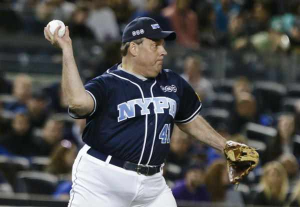 """<div class=""""meta image-caption""""><div class=""""origin-logo origin-image none""""><span>none</span></div><span class=""""caption-text"""">New Jersey Gov. Chris Christie throws to second base during the first inning of the """"True Blue"""" benefit celebrity softball game at Yankee Stadium  (AP Photo/ Frank Franklin II)</span></div>"""