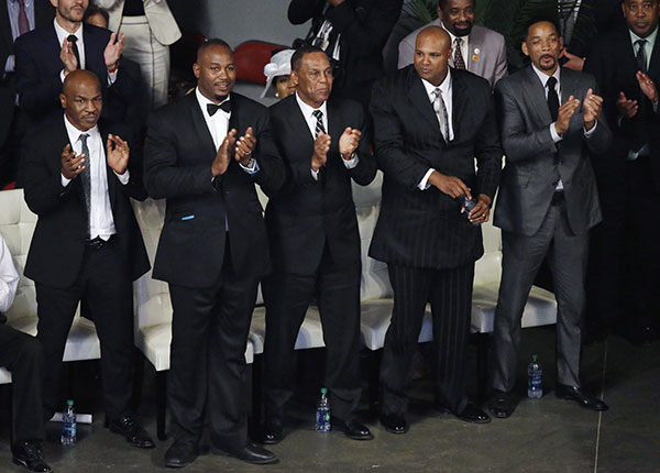 "<div class=""meta image-caption""><div class=""origin-logo origin-image none""><span>none</span></div><span class=""caption-text"">Pallbearers Mike Tyson, left, Lennox Lewis, second from left, Will Smith, right, and Mike Moorer, second from right, stand during Muhammad Ali's memorial service. (Darron Cummings/AP Photo)</span></div>"