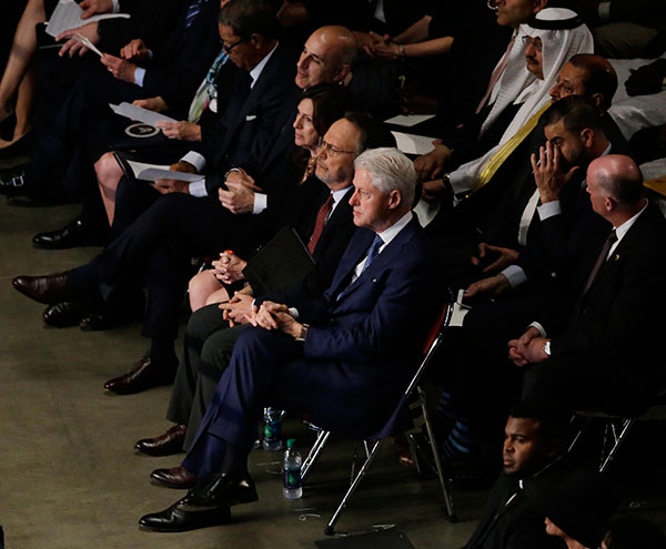 "<div class=""meta image-caption""><div class=""origin-logo origin-image none""><span>none</span></div><span class=""caption-text"">Former President Bill Clinton sits with comedian Billy Crystal along with other guests during Muhammad Ali's memorial service, Friday, June 10, 2016, in Louisville, Ky. (Darron Cummings/AP Photo)</span></div>"