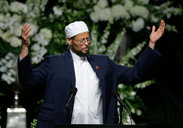 "<div class=""meta image-caption""><div class=""origin-logo origin-image none""><span>none</span></div><span class=""caption-text"">Imam Zaid Shakir introduces speakers during Muhammad Ali's memorial service, Friday, June 10, 2016, in Louisville, Ky. (David Goldman/AP Photo)</span></div>"