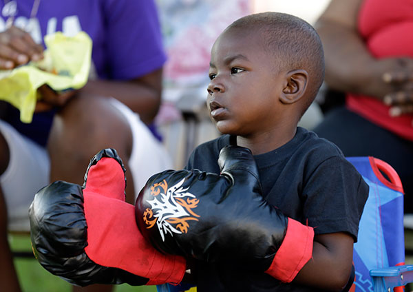 "<div class=""meta image-caption""><div class=""origin-logo origin-image none""><span>none</span></div><span class=""caption-text"">Tymetrius Steward, 3, wears boxing gloves to honor Muhammad Ali as he awaits his funeral procession to make its way down Muhammad Ali Boulevard in Louisville, Ky. Friday, June 10. (Michael Conroy/AP Photo)</span></div>"