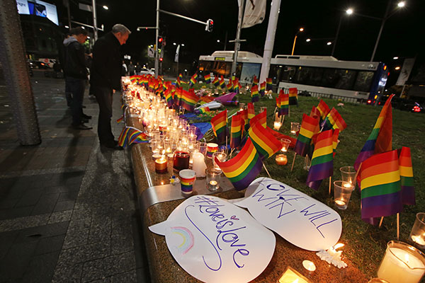 <div class='meta'><div class='origin-logo' data-origin='none'></div><span class='caption-text' data-credit='Rick Rycroft/AP Photo'>An impromptu memorial is set up in Sydney, Monday, June 13, 2016, following the Florida mass shooting at the Pulse Orlando nightclub.</span></div>