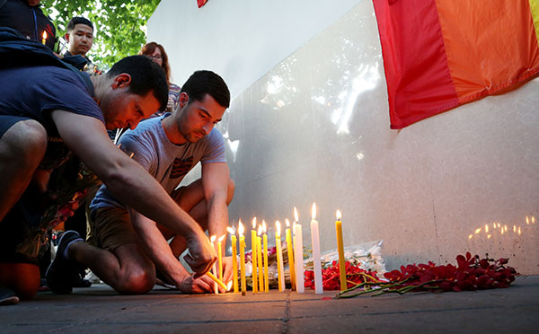 <div class='meta'><div class='origin-logo' data-origin='none'></div><span class='caption-text' data-credit='Mark Baker/AP Photo'>Visitors place candles at a vigil outside the US Embassy in Bangkok, Thailand on Monday, June 13, 2016 for those killed and wounded in Sunday's mass shooting.</span></div>
