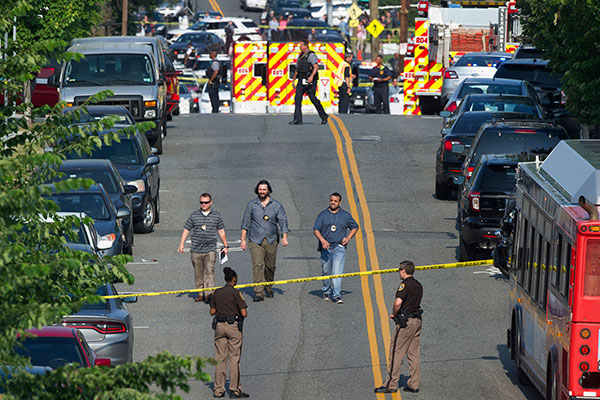"<div class=""meta image-caption""><div class=""origin-logo origin-image none""><span>none</span></div><span class=""caption-text"">Police and emergency personnel are seen near the scene of a shooting during a Congressional baseball practice in Alexandria, Va., Wednesday, June 14, 2017. (Cliff Owen/AP Photo)</span></div>"