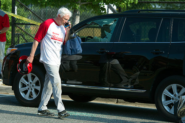 <div class='meta'><div class='origin-logo' data-origin='none'></div><span class='caption-text' data-credit='Cliff Owen/AP Photo'>Rep. Jack Bergman, R-Mich. talks on the phone while walking past a damaged vehicle at a shooting scene where House Majority Whip Steve Scalise of La. was shot.</span></div>