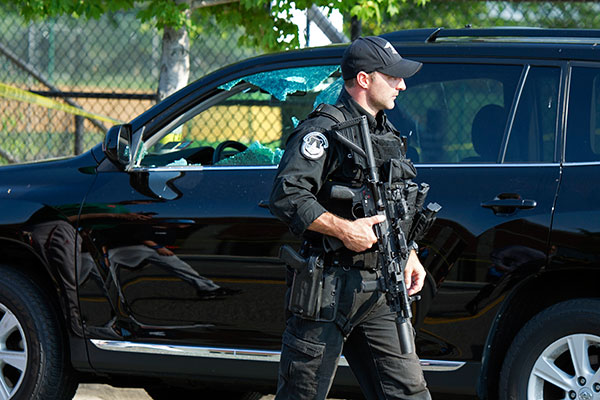 "<div class=""meta image-caption""><div class=""origin-logo origin-image none""><span>none</span></div><span class=""caption-text"">A Capitol Hill Police officer walks past an automobile with the driver's window damaged at the scene of a shooting in Alexandria, Va., Wednesday, June 14, 2017. (Cliff Owen/AP Photo)</span></div>"