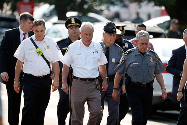 <div class='meta'><div class='origin-logo' data-origin='none'></div><span class='caption-text' data-credit='Alex Brandon/AP Photo'>Alexandria, Va. Police Chief Michael Brown, right, and others walk to speak to the media about the shooting in Alexandria, Va., Wednesday, June 14, 2017.</span></div>